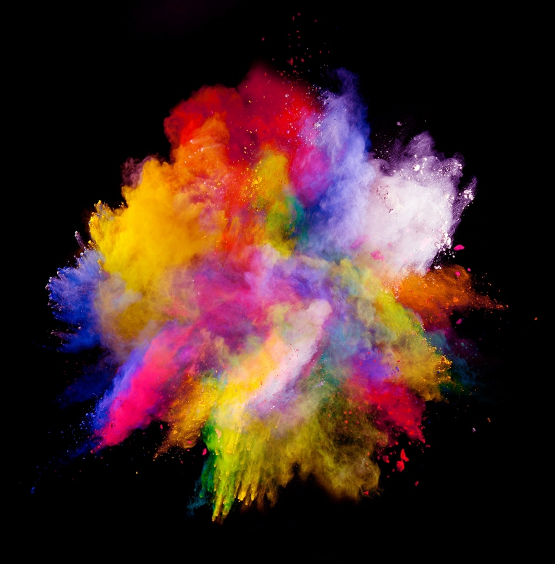 Freeze motion of colored dust explosion isolated on black backgr